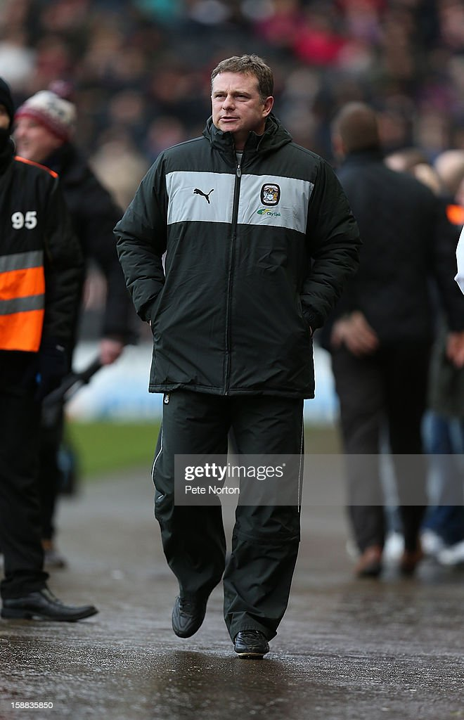Coventry City manager Mark Robins walks to the dug out prior to the npower League One match between Milton Keynes Dons and Coventry City at Stadium mk on December 29, 2012 in Milton Keynes, England.