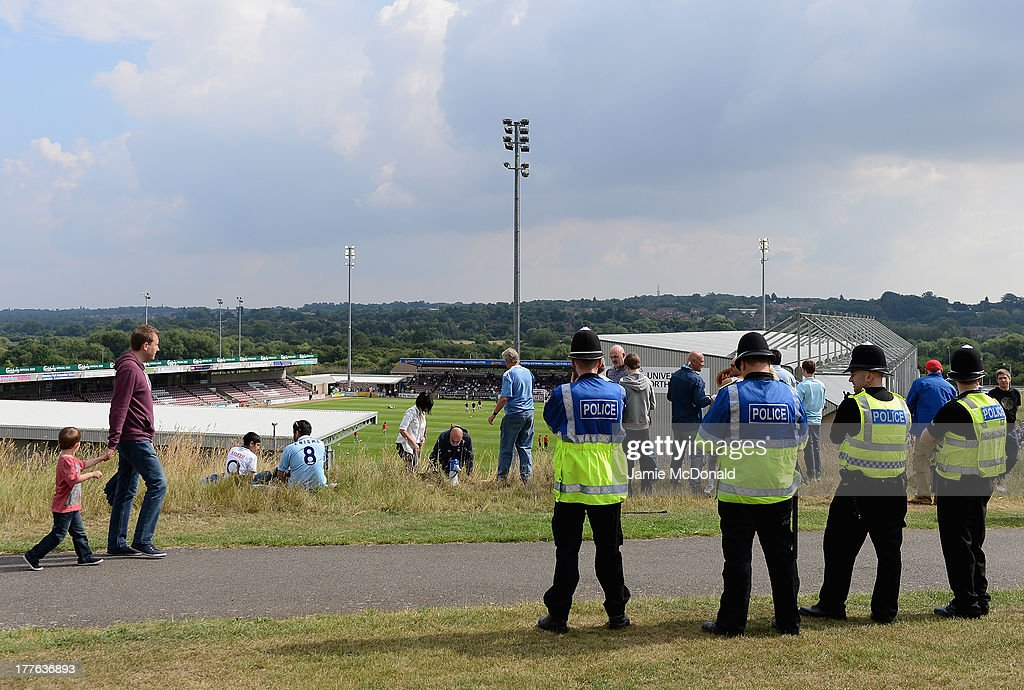 Coventry City protesters watch on from the hill over looking the stadium during the Sky Bet League One match between Coventry City and Preston North End at Sixfields on August 25, 2013 in Northampton, England.