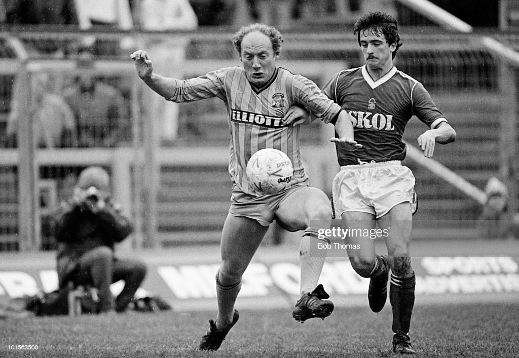 Coventry City striker Alan Brazil (left) under pressure from Nottingham Forest defender Gary Fleming during the Division One match held at Highfield Road, Coventry on 29th March 1986. The match ended in a 0-0 draw. (Bob Thomas/Getty Images).