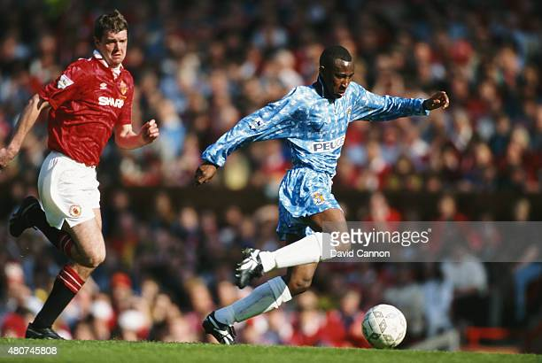 Coventry City striker Peter Ndlovu outpaces Manchester United defender Gary Pallister during a FA Premier League match between Manchester United and...