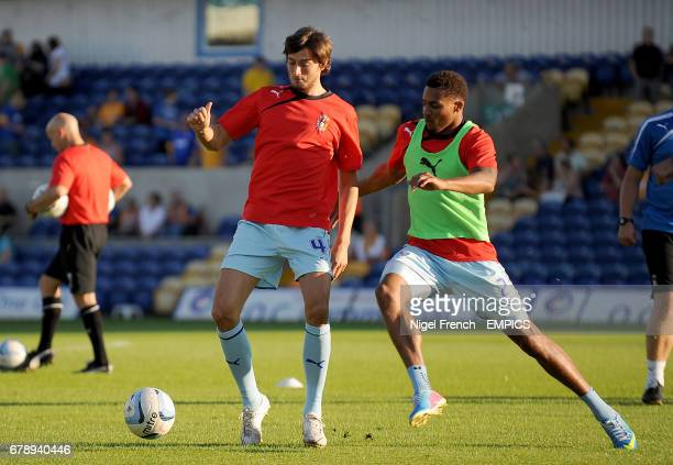 Coventry City's Adam Barton and Cyrus Christie battle for the ball in prematch training