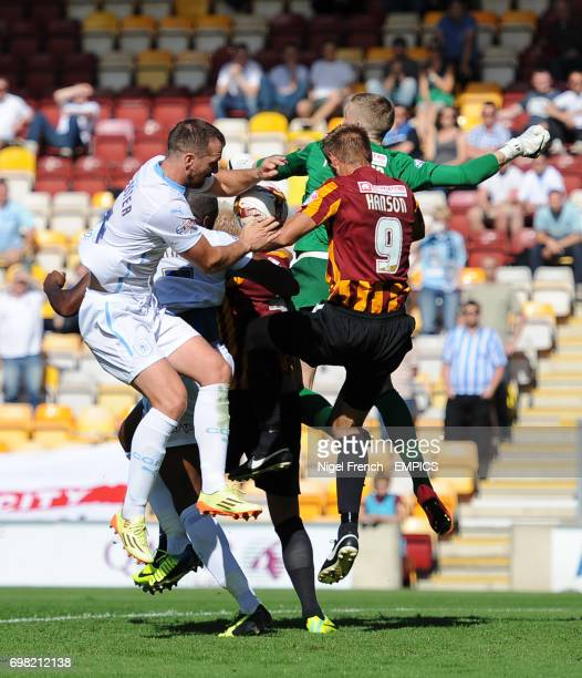 Coventry City's Andrew Webster challenges Bradford City's Jordan Pickford and James Hanson for the ball
