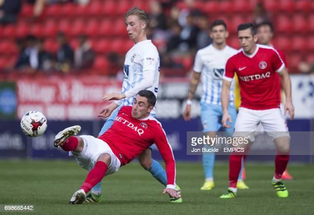 Coventry City's Ben Stevenson challenges Charlton Athletics Lee Novak