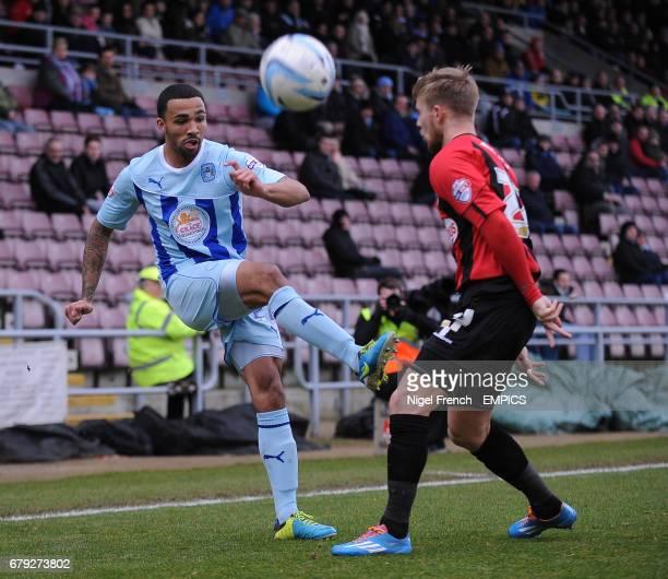 Coventry City's Callum Wilson and Shrewsbury Town's Joseph Mills battle for the ball