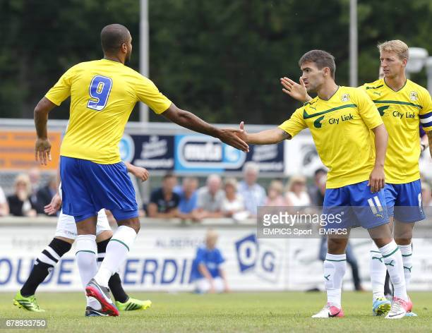Coventry City's Carl Baker celebrates scoring with team mate Israel Bascon and Leon Clarke