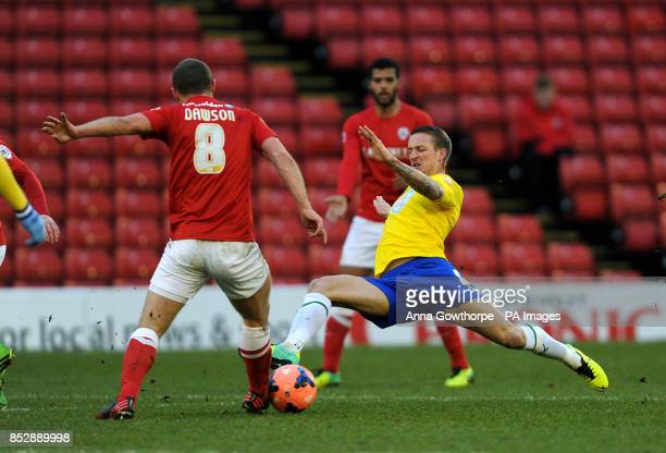 Coventry City''s Carl Barker puts in a strong challenge on Barnsley's Stephen Dawson during the FA Cup Third Round match at the Oakwell Stadium...