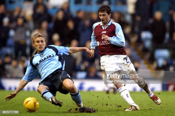Coventry City's Craig Pead challenges Burnley's Dimitrios Papadopoulos