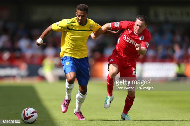 Coventry City's Cyrus Christie and Crawley Town's Mike Jones battle for the ball
