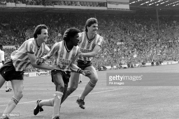 Coventry City's Dave Bennett celebrates with teammates Keith Houchen and Nick Pickering after scoring his team's first equalizing goal to make the...