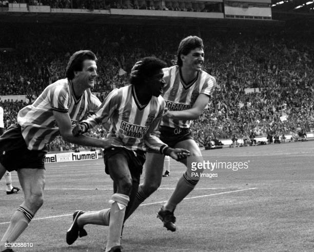 Coventry City's Dave Bennett is congratulated by teammates Keith Houchen and Nick Pickering after heading in the first equaliser nine minutes into...