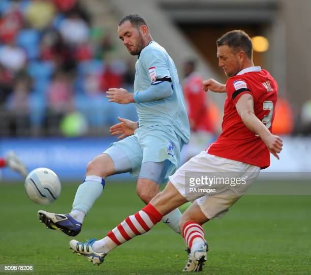 Coventry City's David Bell and Nottingham Forest's Clint Hill during the npower Football League Championship match at the Ricoh Arena Coventry