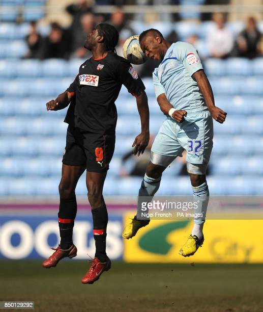 Coventry City's Franck Moussa and Brentford's Clayton Donaldson battle for the ball during the npower Football League One match at the Ricoh Arena...