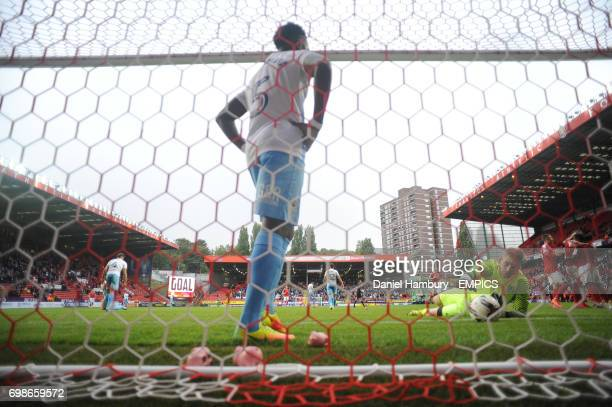 Coventry City's Gael Bigirimana collects the ball from his own net as goal keeper Lee Burge lies on the pitch following Charlton Athletic's Ademola...