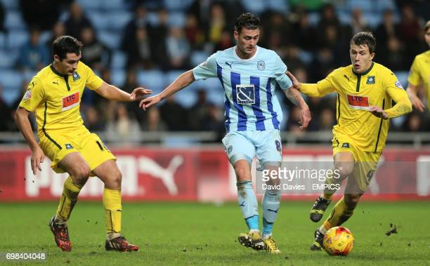 Coventry City's Gary Madine takes on Plymouth Argyle's Carl McHugh and Lee Cox