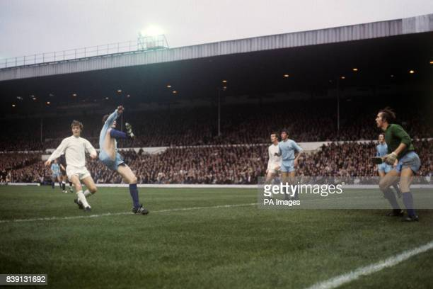 Coventry City's Geoff Strong clears the ball over his head watched by goalkeeper Bill Glazier