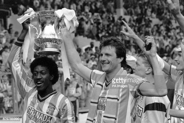 Coventry City's goalscorers Dave Bennett and Keith Houchen celebrate with the FA Cup after their 32 victory