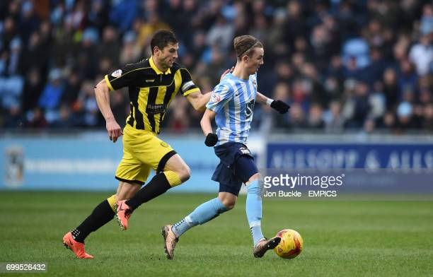 Coventry City's James Maddison is challenged by Burton Albion's John Mousinho