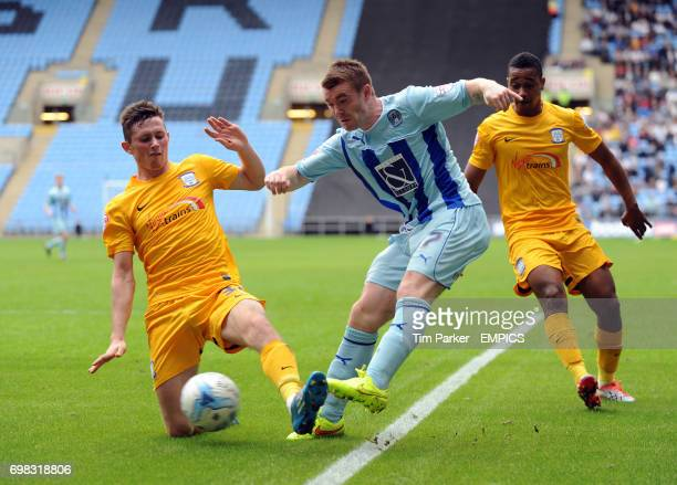 Coventry City's John Fleck and Preston North End's Alan Browne challenge for the ball