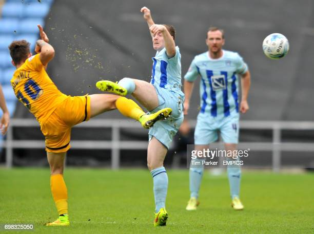 Coventry City's John Fleck takes on Preston North End's Josh Brownhill