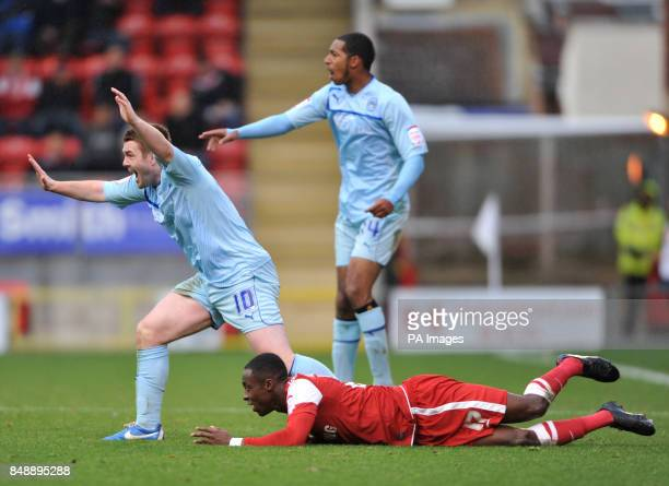 Coventry City's John Fleck with Leyton Orient's Moses Odubajo during the npower League One match at Brisbane Road London