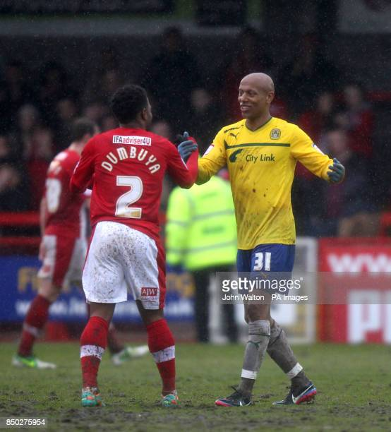 Coventry City's Jordan Stewart and Crawley Town's Mustapha Dumbuya shake hands after the final whistle
