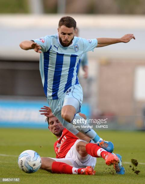 Coventry City's Josh McQuoid tackled by Barnsley's Conor Hourihane