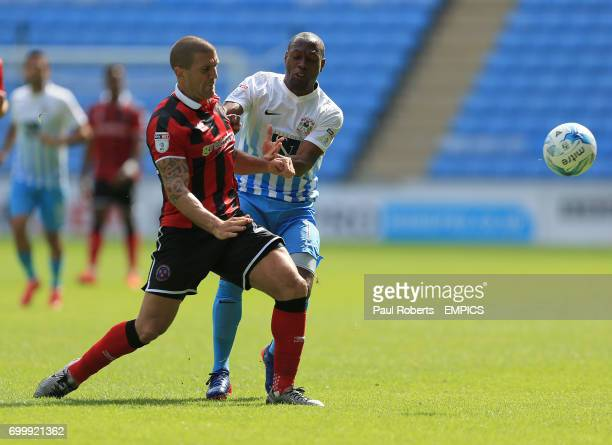 Coventry City's Kyel Reid battles with Shrewsbury Town's Joe Riley