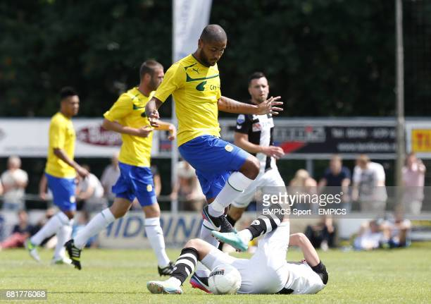 Coventry City's Leon Clarke and Heracles Almelo's Dario Vujicevic battle for the ball