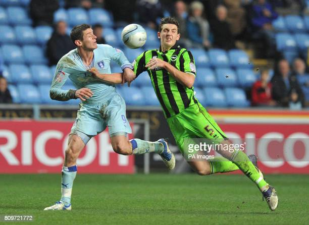 Coventry City's Lucas Jutkiewicz and Brighton Hove Albion's Lewis Dunk battle for the ball during the npower Championship match at the Ricoh Arena...