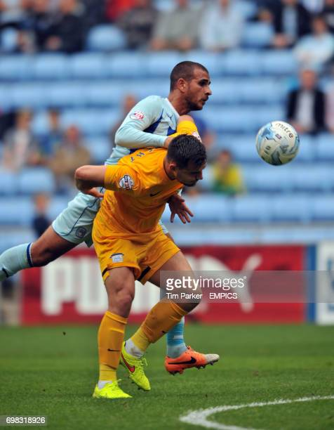 Coventry City's Marcus Tudgay and Preston North End's Bailey Wright challenge for the ball