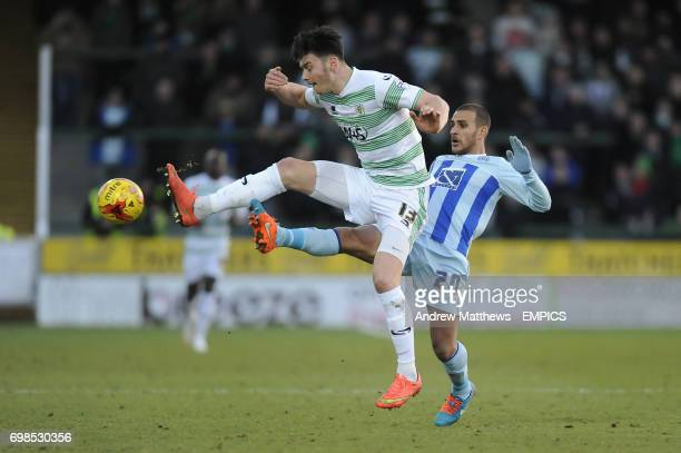 Coventry City's Marcus Tudgay and Yeovil Town's Kieffer Moore battle for the ball