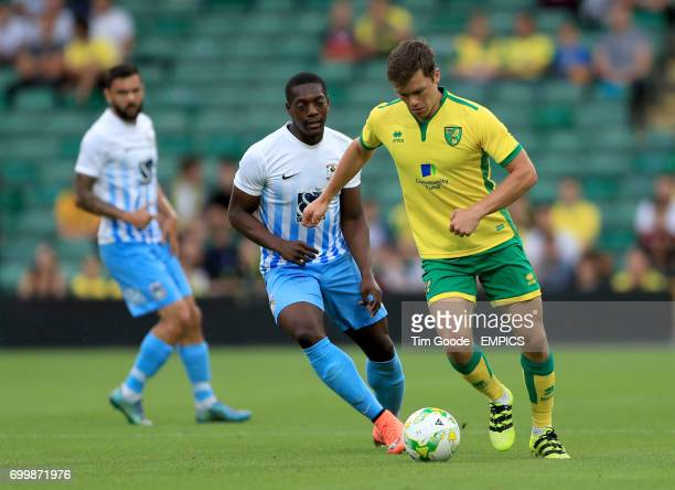 Coventry City's Marin Sordell and Norwich City's Jonny Howson battle for the ball