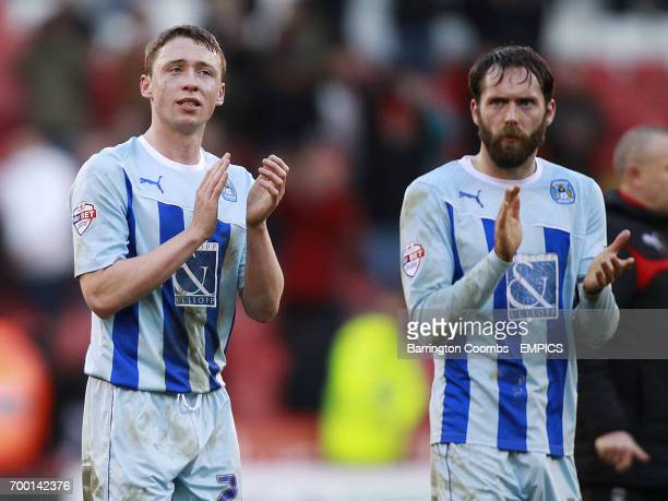 Coventry City's Matthew Pennington and Jim O'Brien applaud the fans at the end of the game