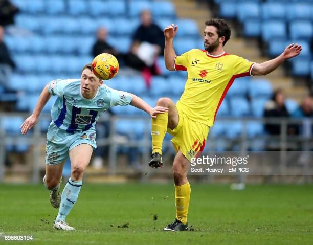Coventry City's Matthew Pennington and Milton Keynes Dons' Will Grigg in action