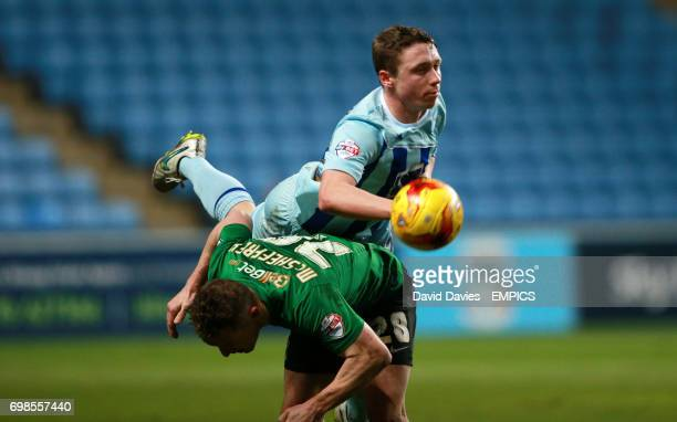 Coventry City's Matthew Pennington and Scunthorpe United's Gary McSheffrey in action