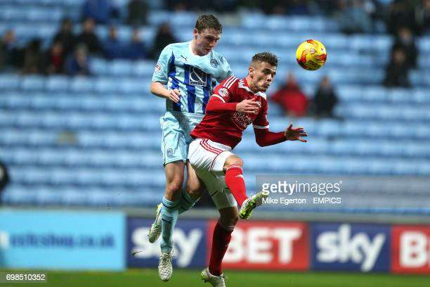 Coventry City's Matthew Pennington and Swindon Town's Harry Toffolo battle for the ball