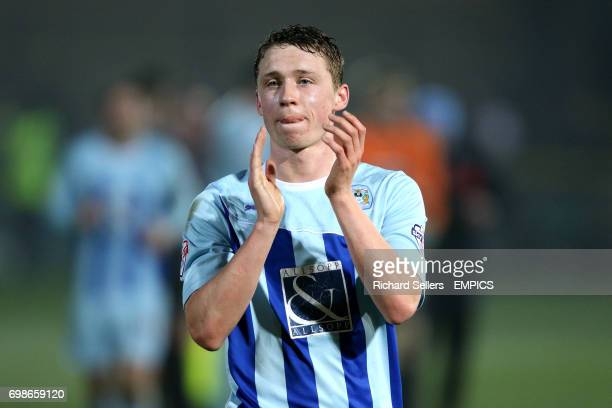 Coventry City's Matthew Pennington applauds the travelling support