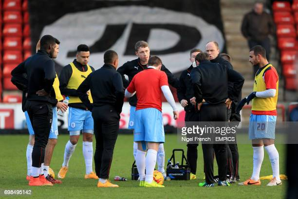 Coventry City's Matthew Pennington listens to a team talk with assistant manager Neil MacFarlane