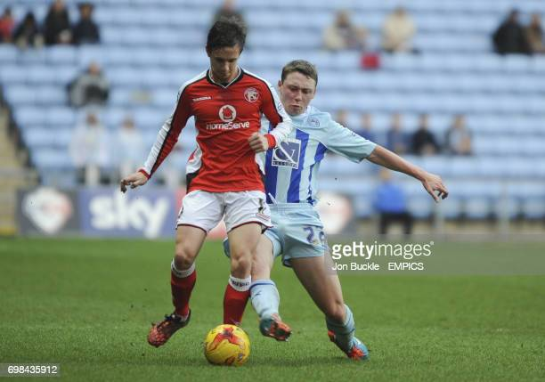 Coventry City's Matthew Pennington Walsall's James Baxendale battle for the ball