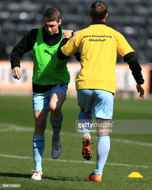 Coventry City's Matthew Pennington warms up prior to the game