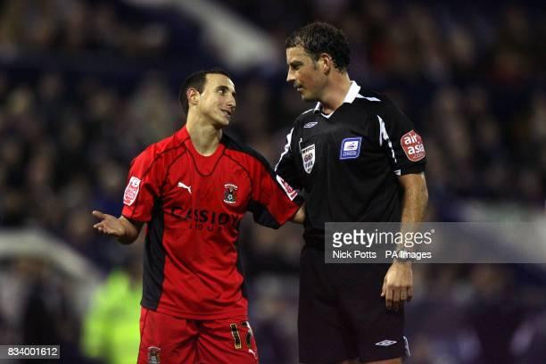 Coventry City's Michael Mifsud talks to referee Mark Clattenburg