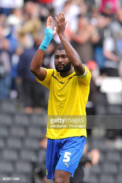 Coventry City's Reda Johnson applauds the travelling support