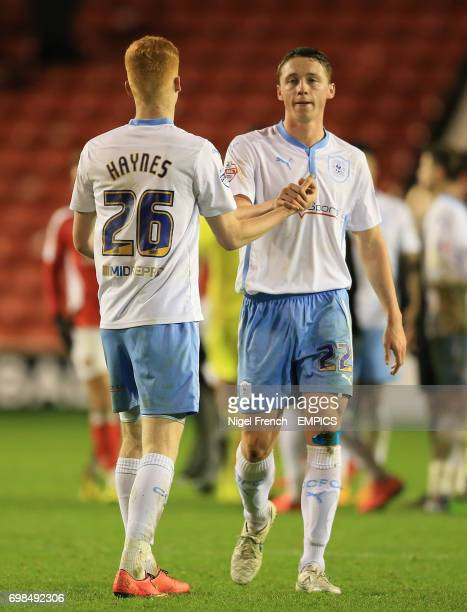 Coventry City's Ryan Haynes and Matthew Pennington celebrate after the final whistle against Walsall