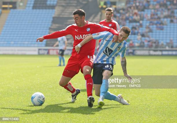 Coventry City's Ryan Kent and Chesterfield's Lee Novak in action