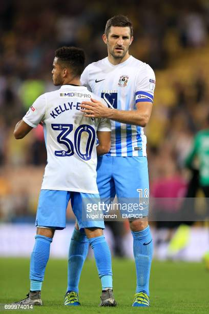 Coventry City's Sam Ricketts embraces Dion KellyEvans at the final whistle