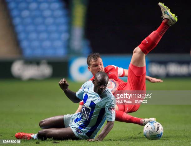 Coventry City's Sanmi Odelusi wins ball beating Leyton Orient's Shane Lowry