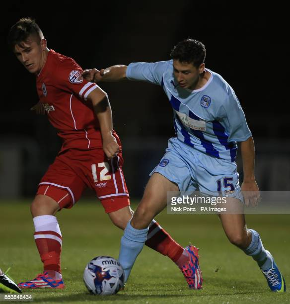 Coventry City's Shaun Miller battles for ball with Cardiff City's Declan John during the Capital One Cup First Round match at Sixfields Stadium...