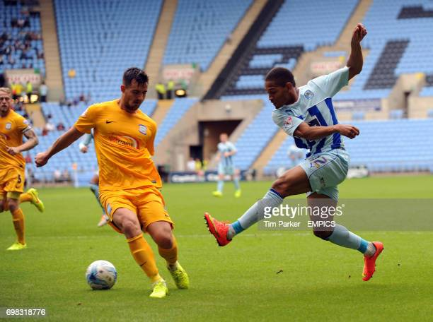 Coventry City's Simeon Jackson and Preston North End's Bailey Wright challenge for the ball