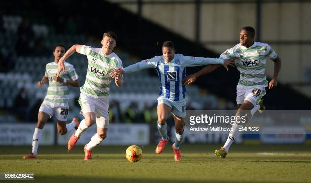 Coventry City's Simeon Jackson holds off challenges from Yeovil Town's Stephen Arthurworrey and Kieffer Moore