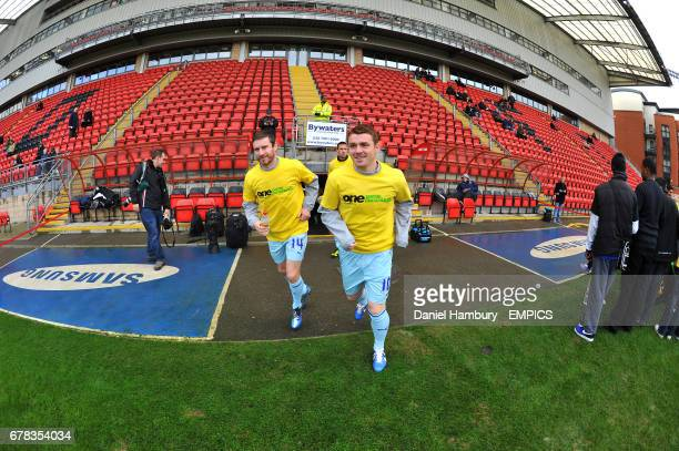 Coventry City's Stephen Elliott and John Fleck walk out for the warm up at Brisbane Road